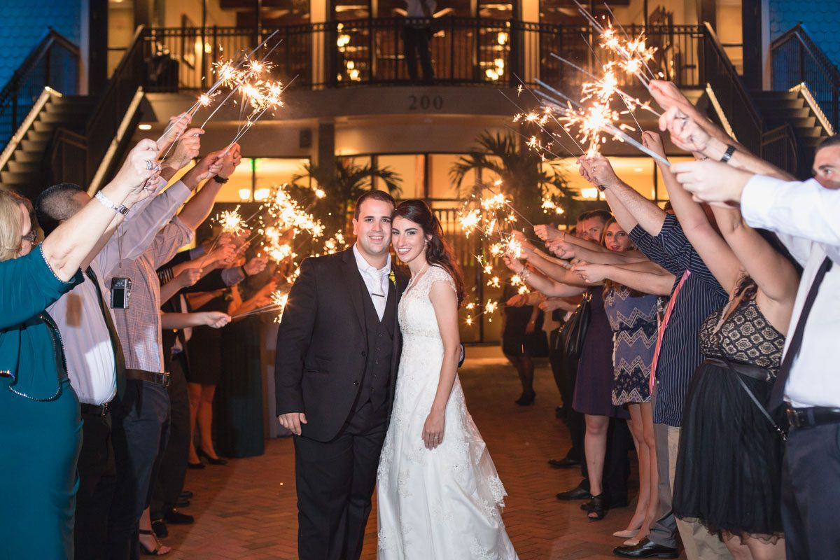 Sparkler exit by top Orlando wedding photographer at the Tavares Pavilion on the Lake
