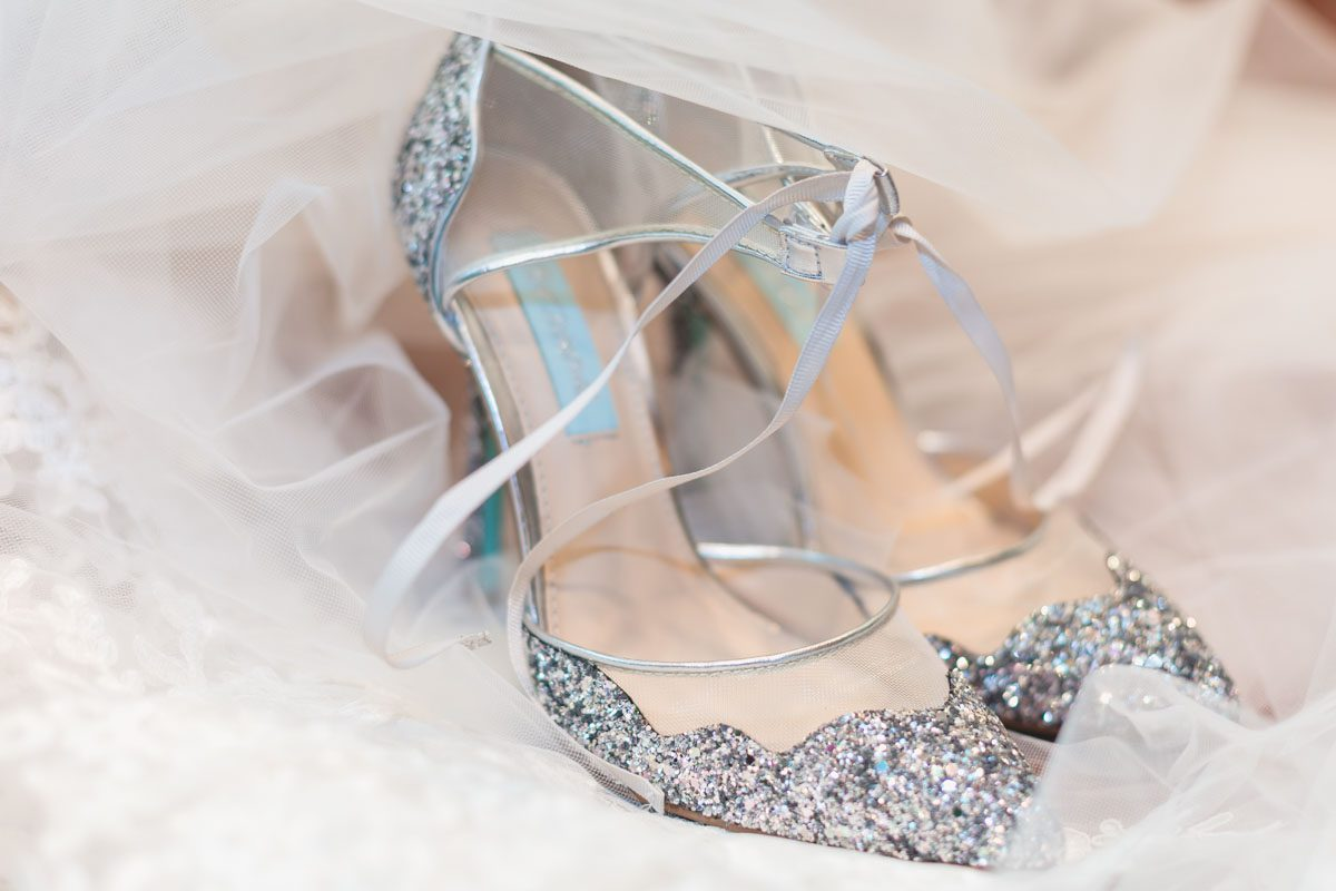 Top Orlando Wedding Photographer Captures Night Time Rainy Day At The Tavares Pavilion On Maggie Sottero Dress Blue Shoes