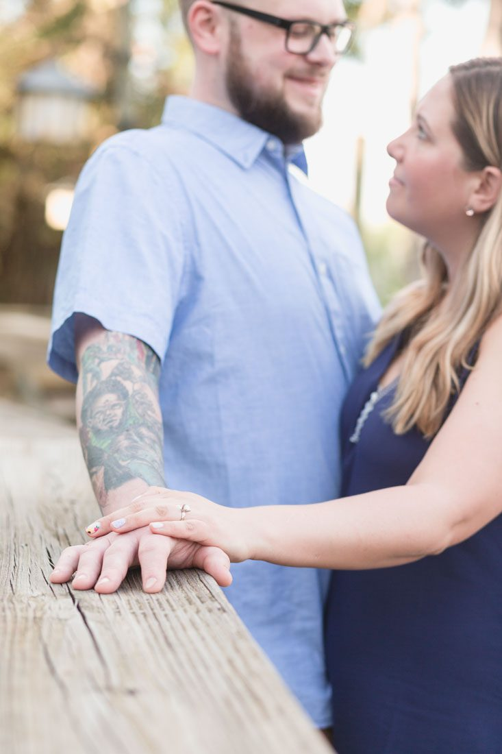 Engaged couple at their photo session captured by top Orlando wedding photographer at a Disney resort