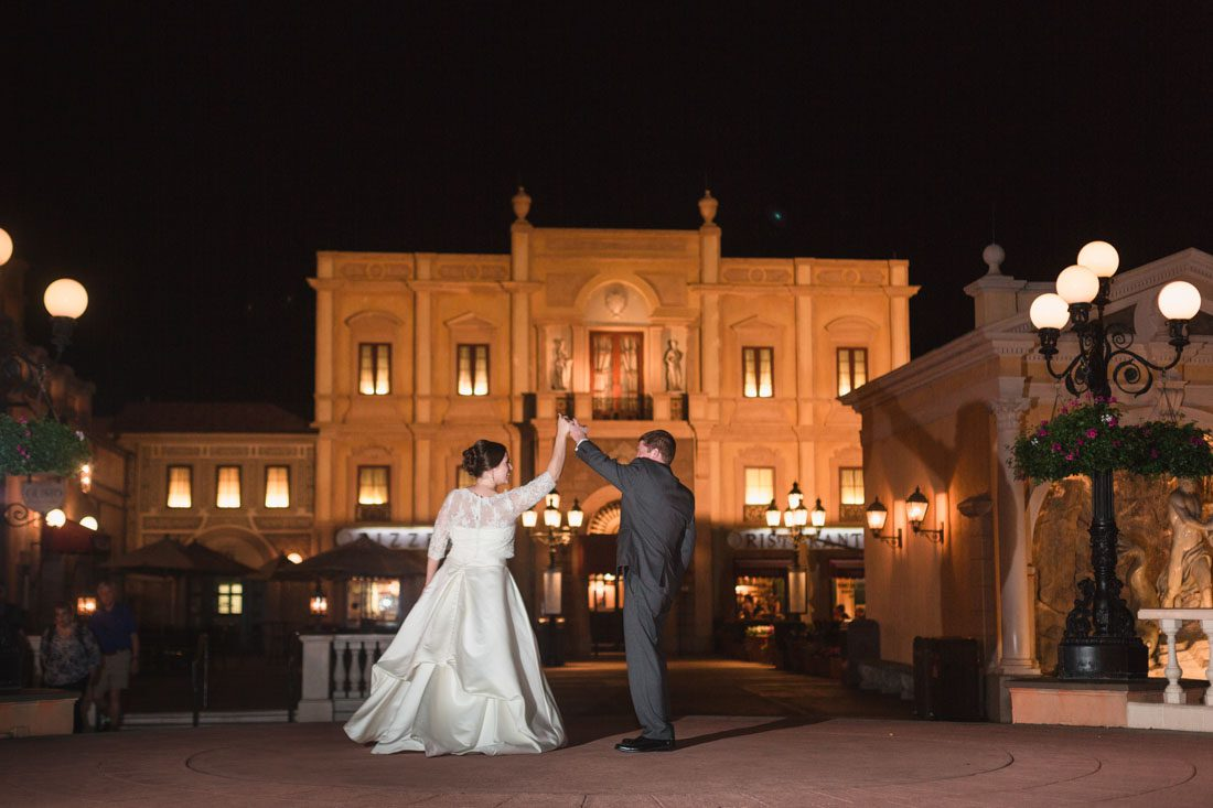 Disney wedding couple poses in Italy at Epcot during their dessert party