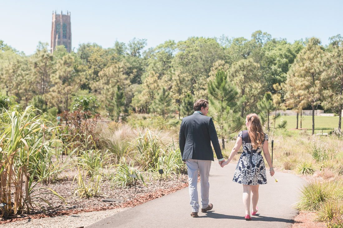Walking through Bok Tower botanical gardens during their engagement photography shoot with Orlando photographer