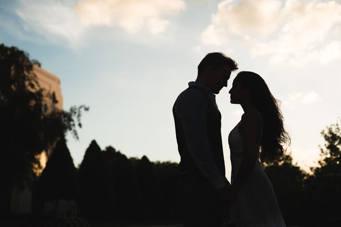Unique silhouette of a couple during their sunset engagement photography session with top Orlando wedding photographer and videographer