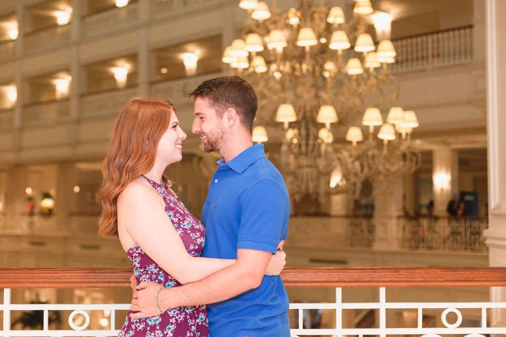 Engagement photography session at the Grand Floridian hotel featuring the beautiful chandelier captured by top Orlando photographer