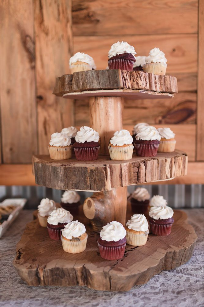 Rustic wooden cupcake stand for a country wedding at a barn in Sumterville, Florida