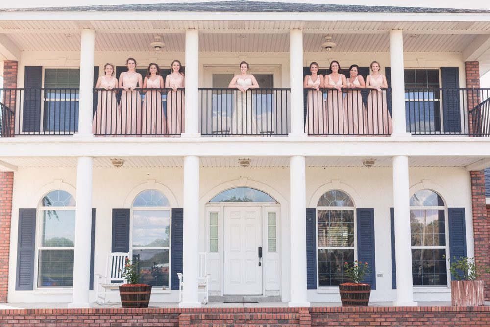bridesmaids featuring blush dresses for their country wedding day at a barn in Central Florida captured by top Orlando photographer