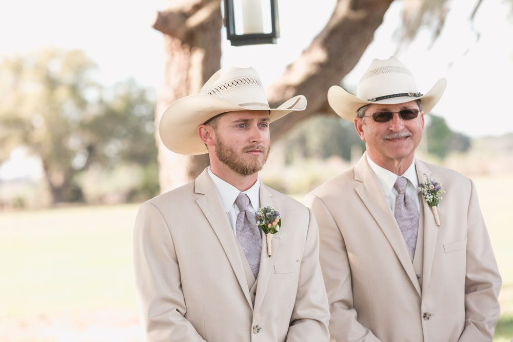Groom's emotional reaction to seeing his bride for the first time at their rustic country inspired Southern wedding in Florida