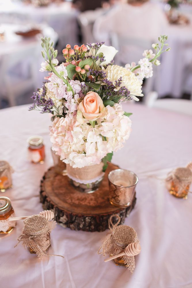 DIY charming country centerpieces at a barn wedding in Sumterville Florida