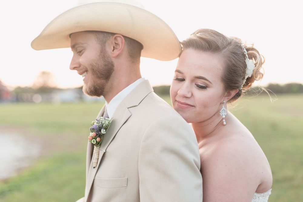 Sunset wedding photos at an outdoor country wedding in Sumterville, north of Orlando captured by top photographer in front of a silo