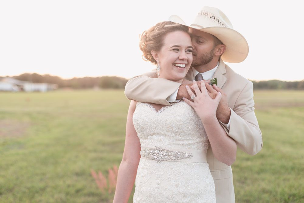 Romantic photo of a country wedding at sunset during their rustic wedding day in Central Florida