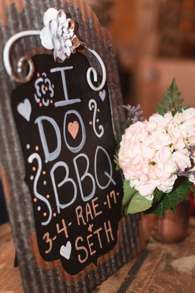 Cute custom decor details for a DIY barn wedding in Sumterville, north of Orlando captured by top wedding photographer