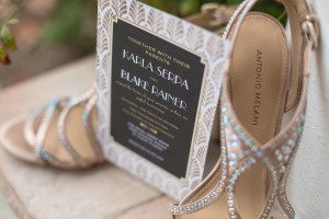 Wedding details including shoes and invitation captured by top Orlando wedding photographer