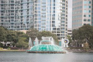 Surprise proposal at Lake Eola followed by an engagement photography session by top Orlando wedding photographer