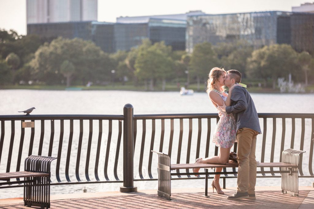 Surprise marriage proposal and engagement session at Lake Eola in Downtown Orlando by top wedding photographer