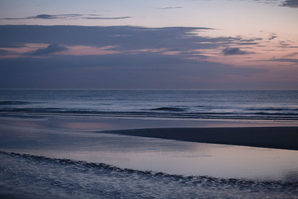 Surprise sunrise proposal at New Smyrna Beach by top Orlando photographer