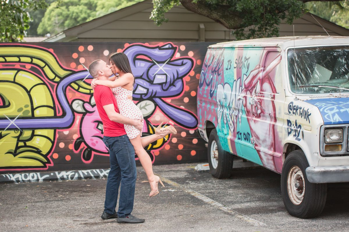 Downtown Orlando engagement session with wine and graffiti by top Orlando wedding photographer