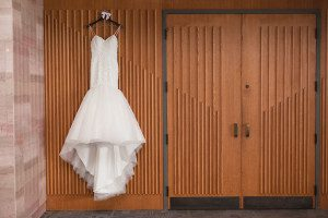 Wedding dress on hanger by top Orlando wedding photographer