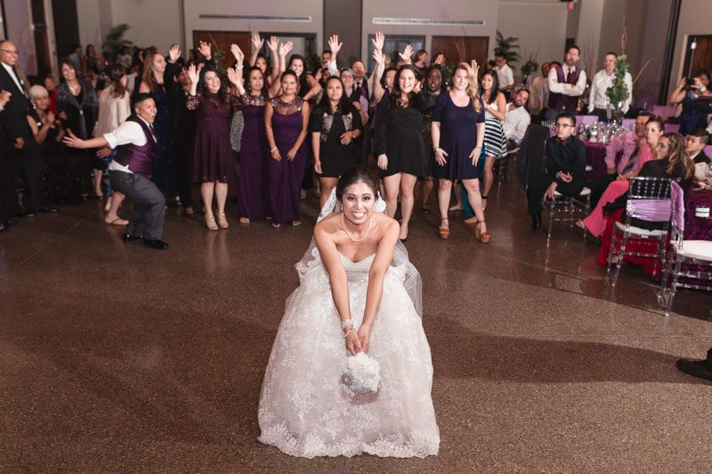 Orlando wedding photographer captures purple wine themed wedding at the Winter Park Civic Center