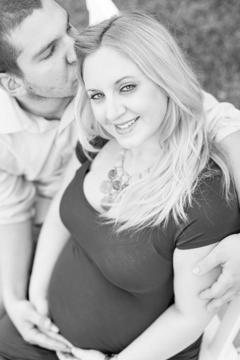 Top Orlando wedding photographer captures maternity portraits for expectant couple at Disney's Boardwalk and Beach club resort in Orlando