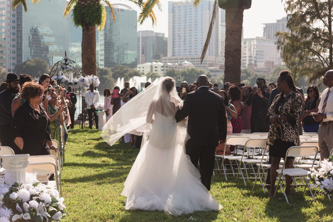 Top Orlando wedding photographer captures wedding at Lake Eola and reception at The Mezz in downtown Orlando