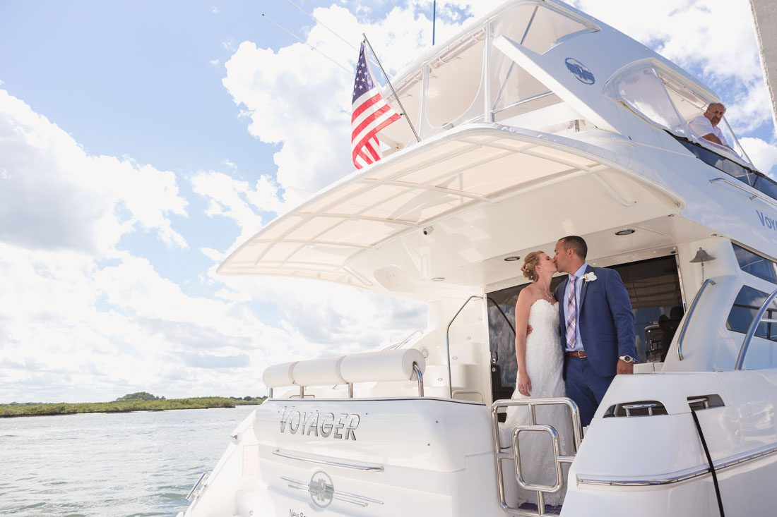 Orlando wedding photographer captures nautical blue themed wedding at Ponce de Leon Inlet and the Smyrna Yacht club in New Smyrna Beach Florida