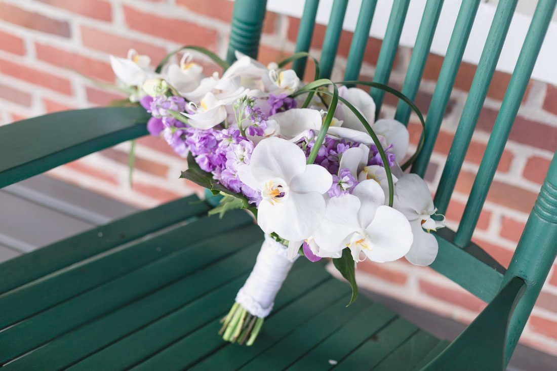 Cascading orchid bouquet for a lighthouse and yacht club wedding by Orlando wedding photographer
