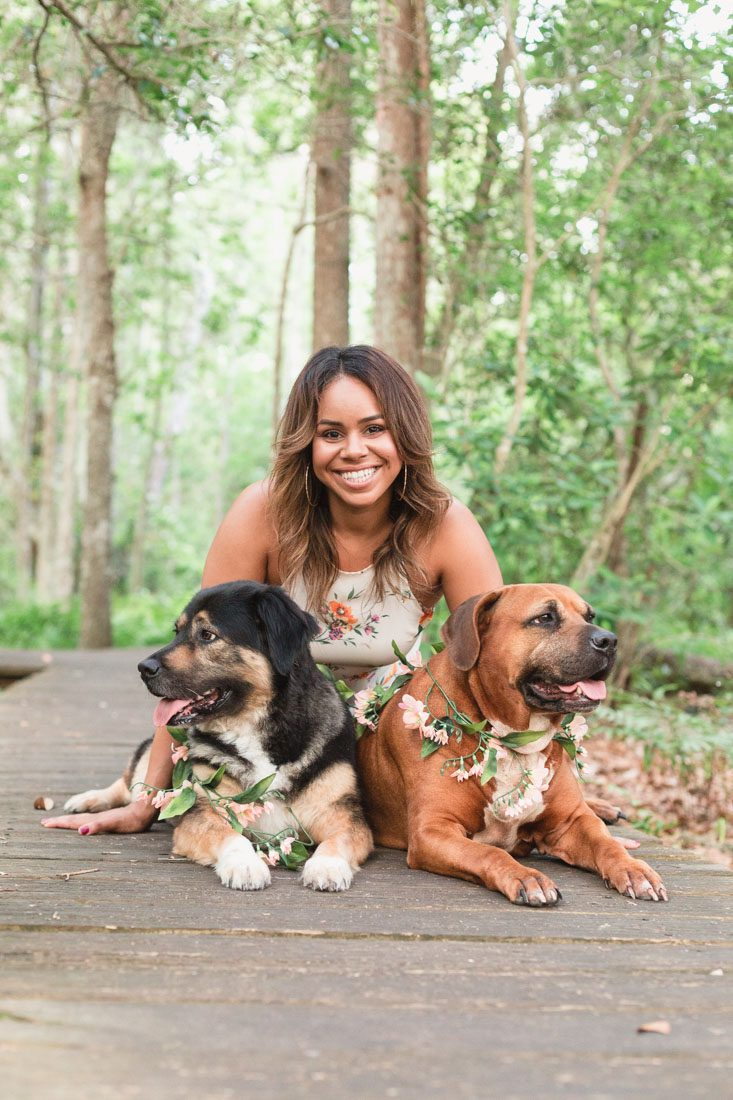 Adorable family photos in the woods with two dogs captured by top Orlando wedding and portrait photographer