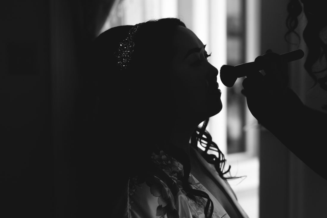 Bride getting ready for her wedding at Crystal Ballroom Veranda captured by top Orlando wedding photographer and videographer