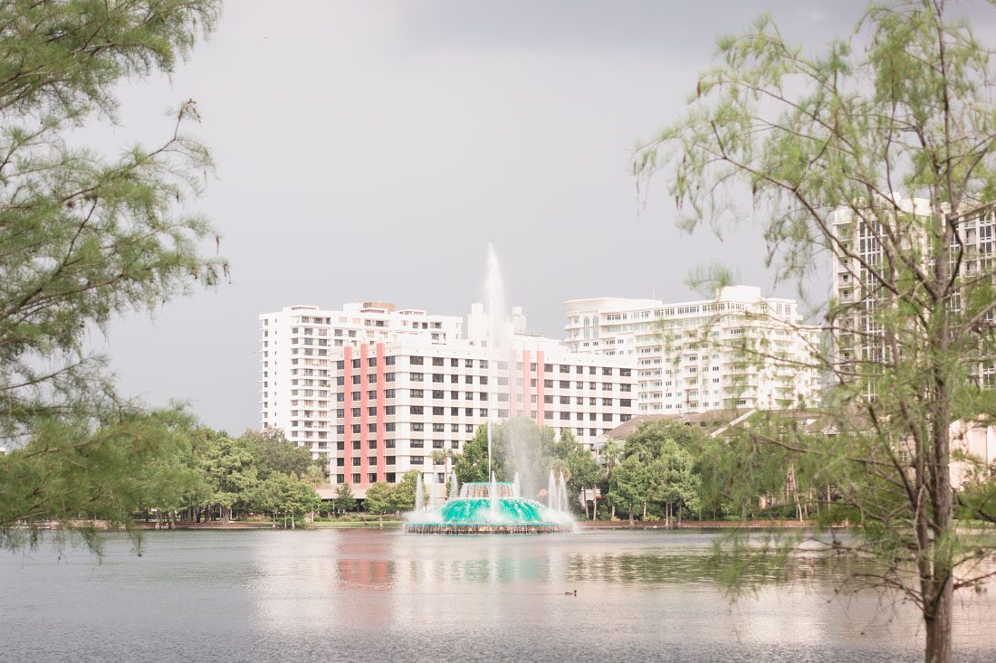 Surprise Orlando proposal photography at Lake Eola park with two kids captured by top Orlando wedding and engagement photographer