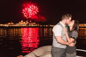 Surprise Orlando proposal photography at Disney's grand floridan under the fireworks captured by top Orlando wedding and engagement photographer