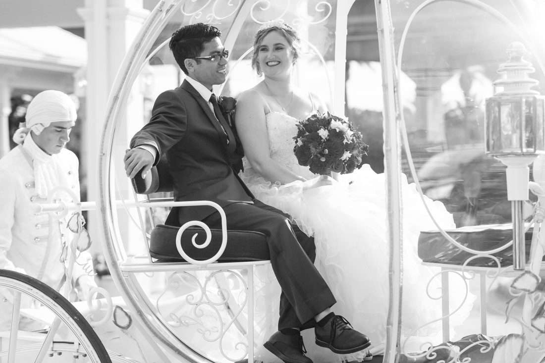 Romantic Disney wedding in Orlando featuring Cinderella's coach and a beauty and the best theme captured by top Orlando wedding photographer and videographer