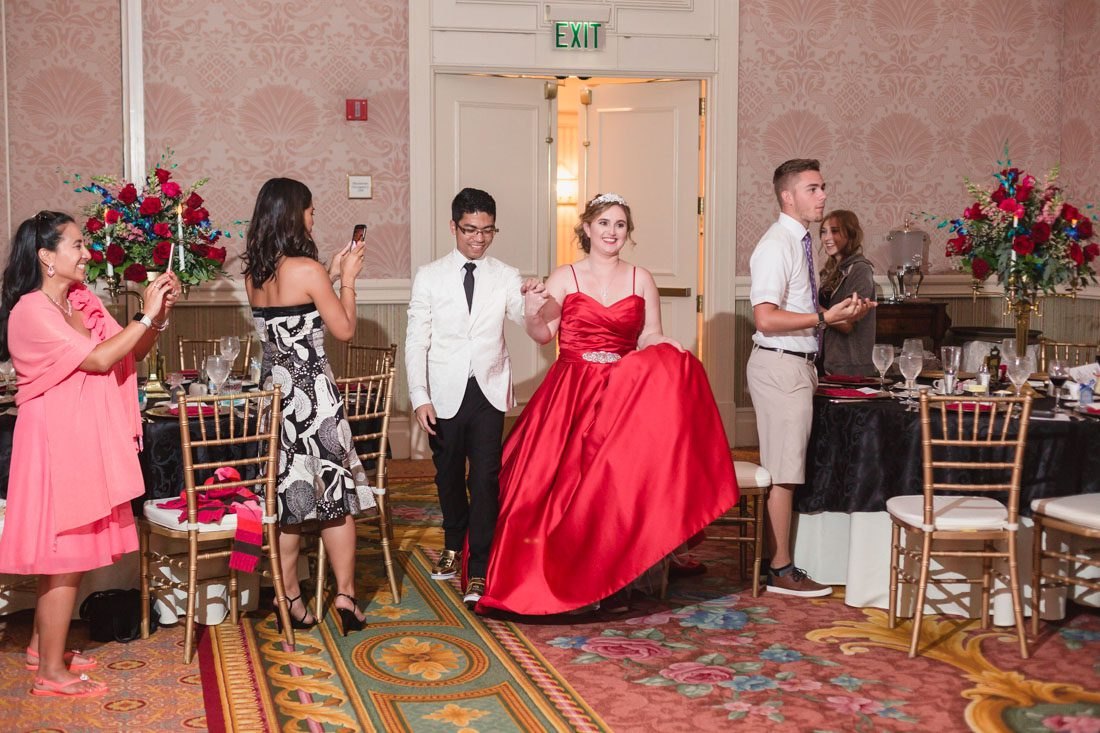 Romantic Disney wedding photography in Orlando featuring a red beauty and the best theme captured by top Orlando wedding photographer and videographer