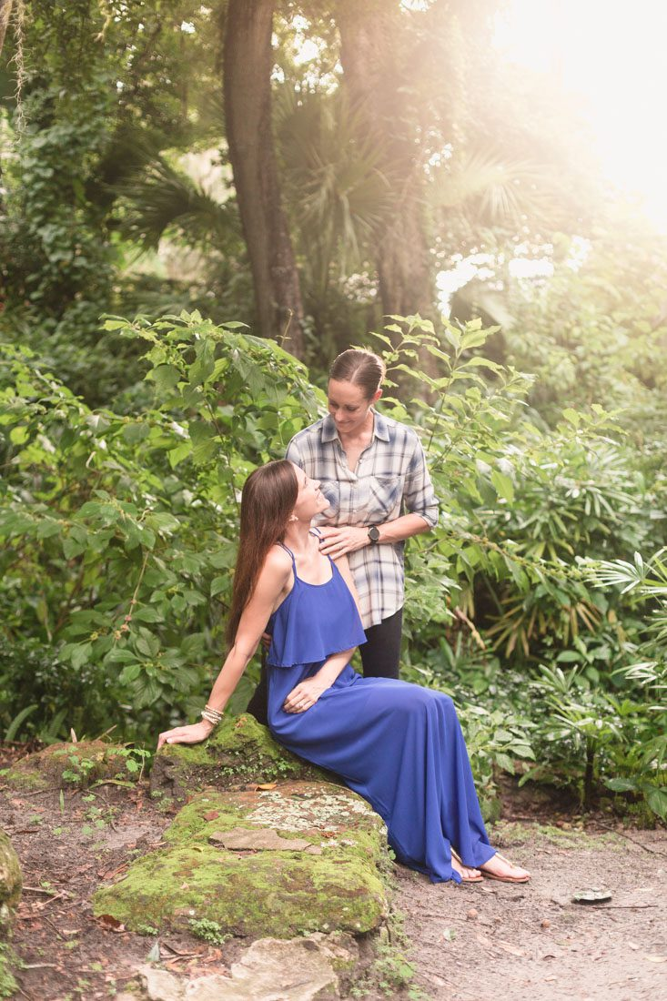 Romantic park LGBT engagement photography session with their adorable puppy dog by top Orlando wedding photographer