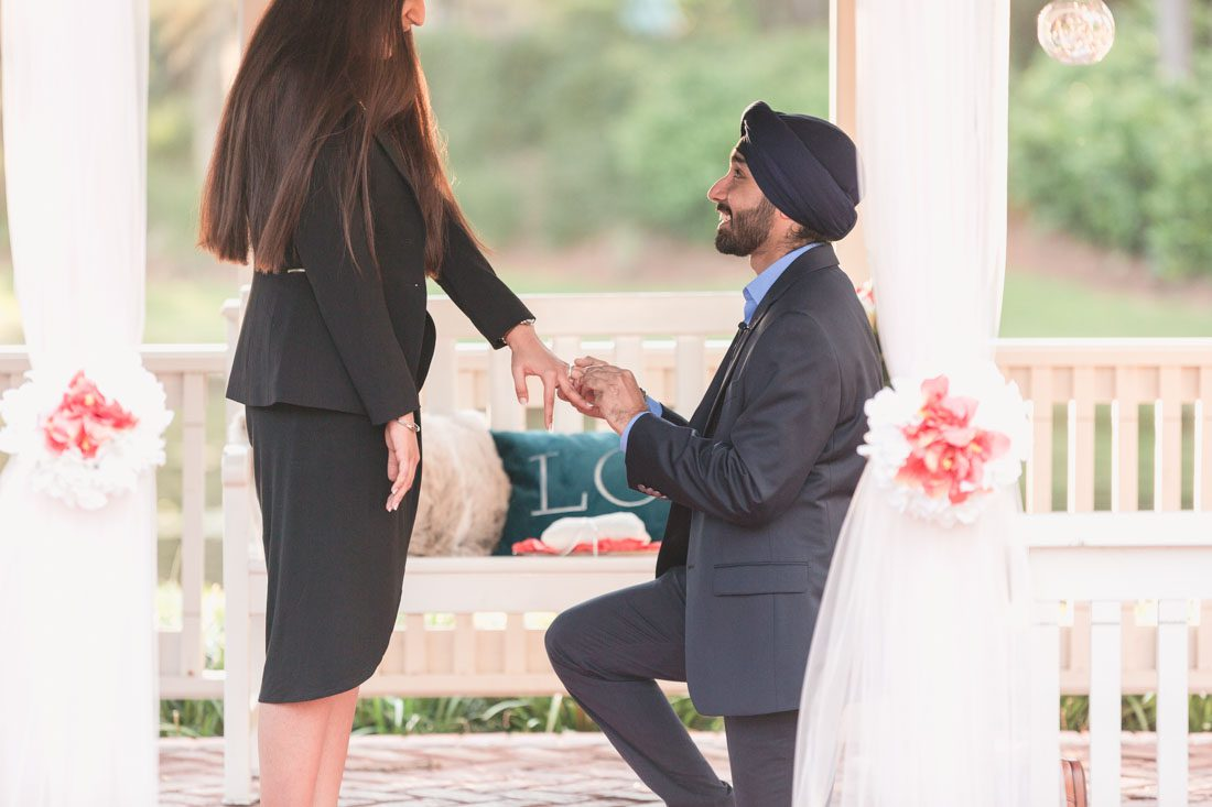 Orlando photographer captures surprise proposal at Disney resort under a beautiful gazebo on the lake