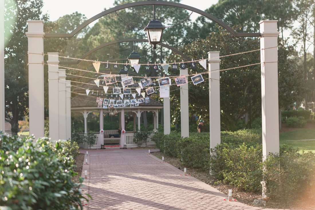 Orlando engagement and proposal photographer captures surprise proposal at Disney resort featuring a gazebo and horse carriage