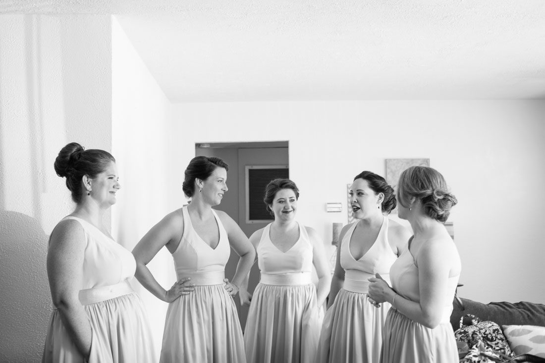 Bridesmaids in champagne and blush dresses get ready for Veranda at Thornton park wedding by Orlando wedding photographer and videographer