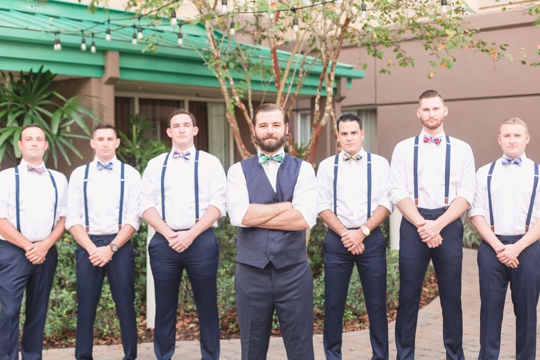 Orlando wedding photographer captures Groom and groomsmen getting ready for Veranda at Thornton park wedding downtown
