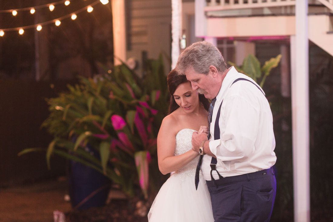 Orlando wedding photographer and videographer capture fun nighttime reception under a tent at the Veranda at Thornton Park