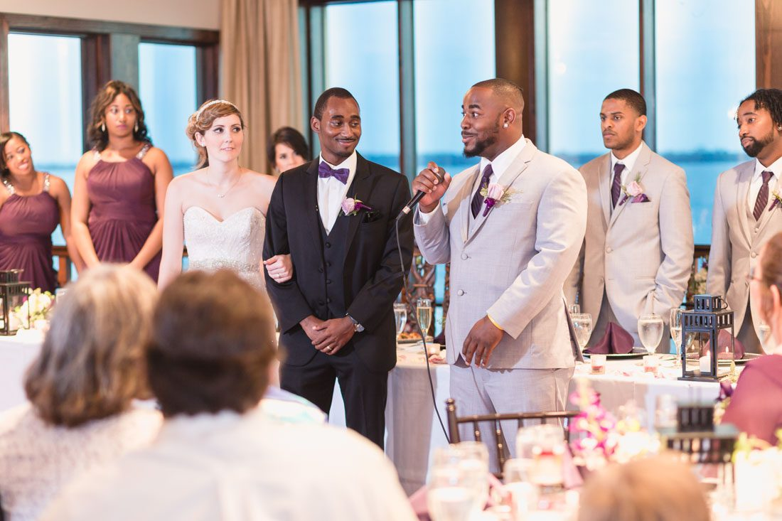 Purple themed wedding at the Tavares Pavilion on the Lake captured by top Orlando wedding photographer and videographer