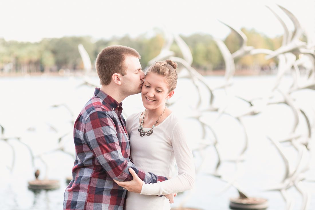 Sweet park engagement session at iconic Lake Eola park in downtown Orlando by top wedding and engagement photographer