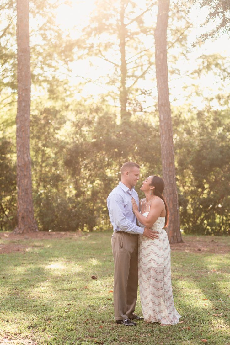 Sunny Fall engagement photography session in downtown Orlando park featuring their dogs
