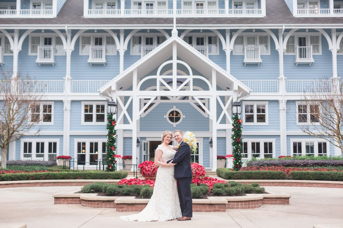 Couples poses for portrait in front of the Disney yacht and beach club for Orlando wedding photographer