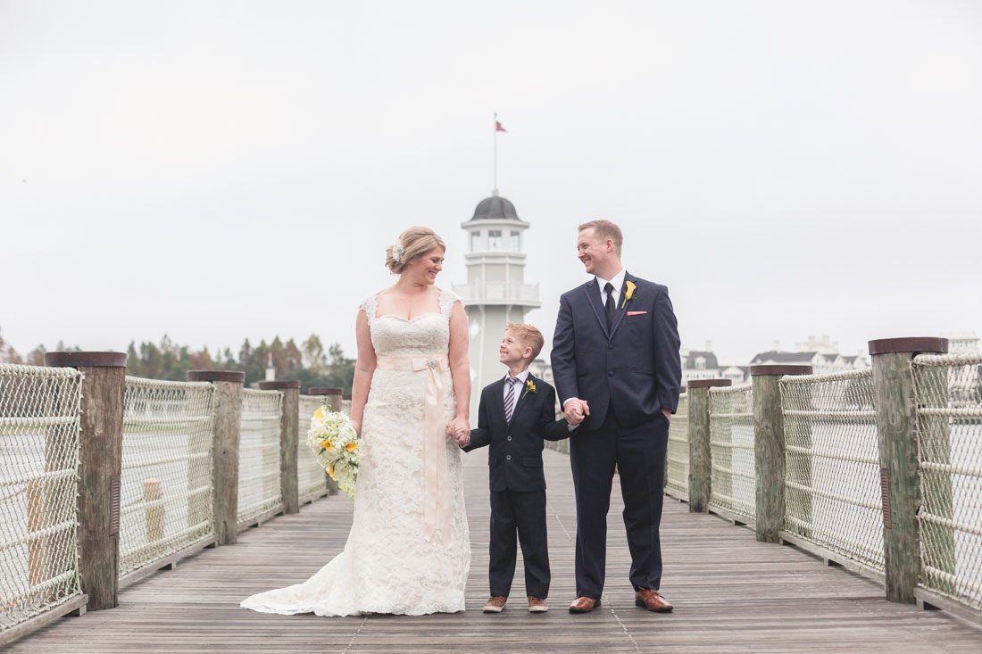 Disney wedding photography at Sea Breeze Point Boardwalk and Epcot park by top Orlando wedding photographer