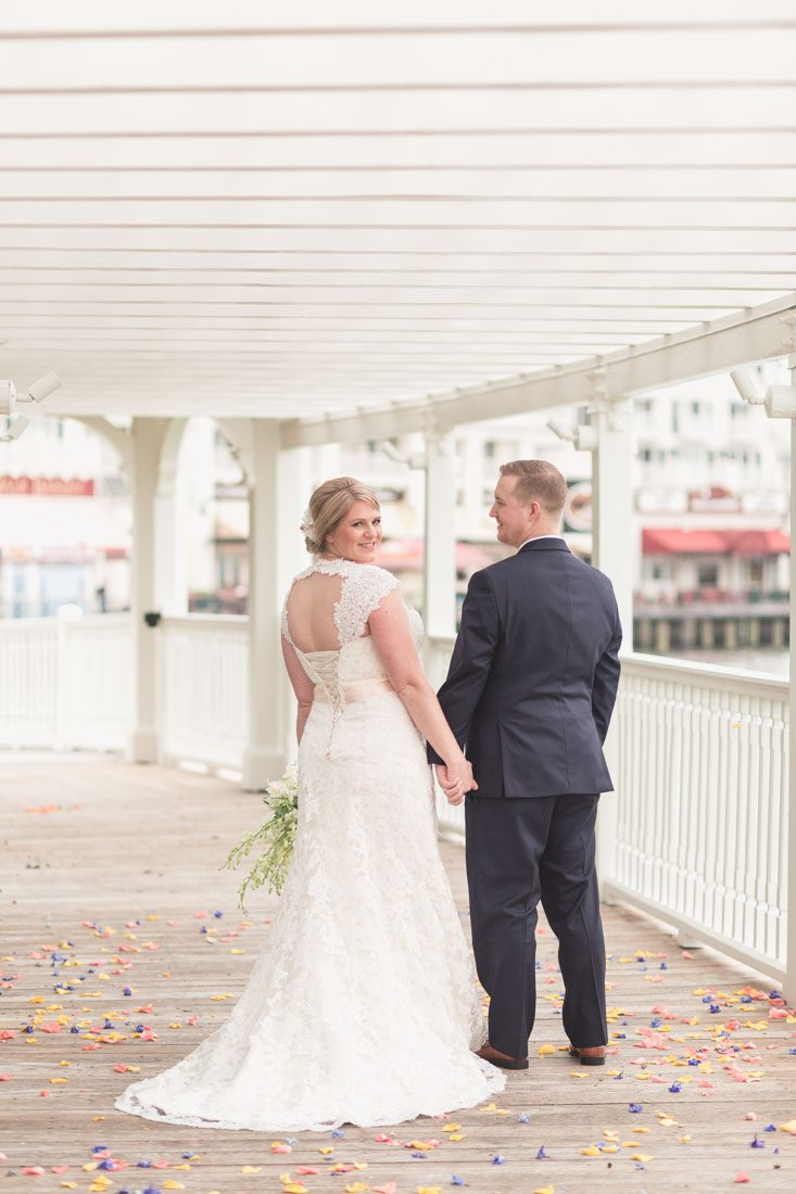 Orlando wedding photographer captures winter Christmas nuptials at Sea Breeze Point at the Boardwalk Inn with reception at Epcot in Disney