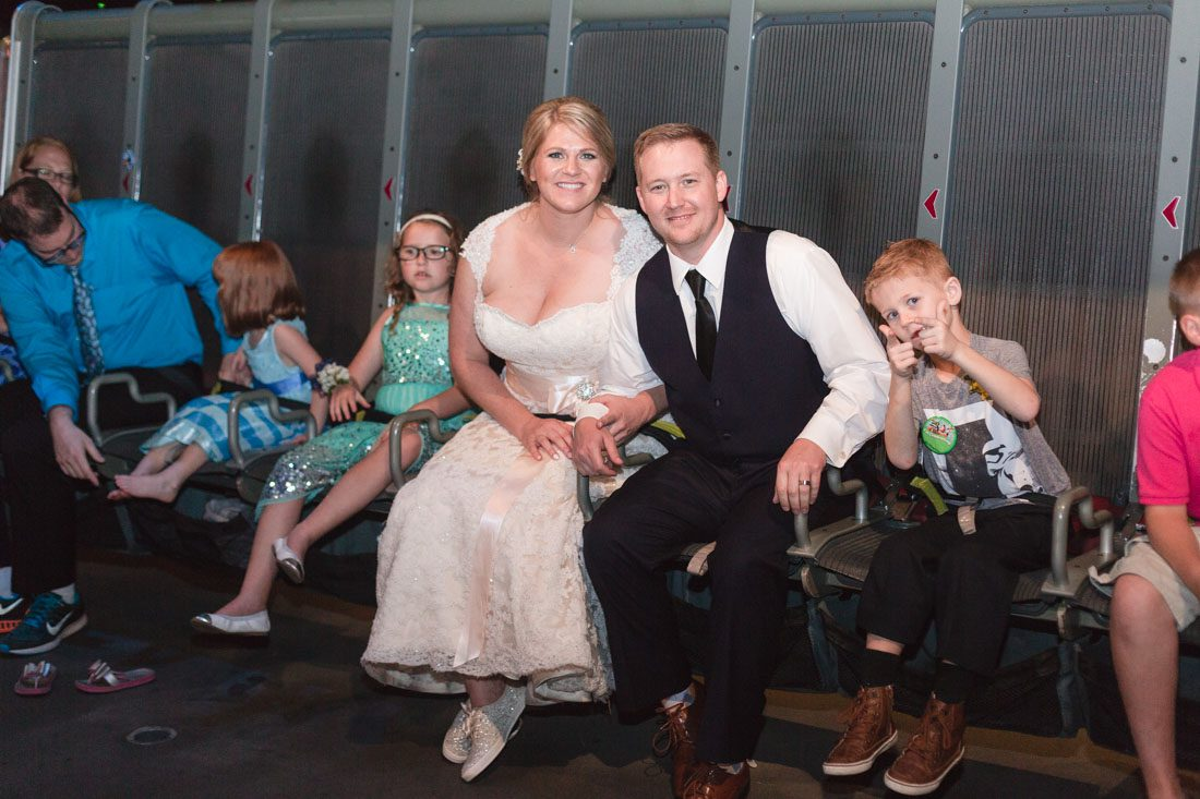 Newlywed couple rides Epcot's Soarin ride during their wedding reception captured by top Disney wedding photographer