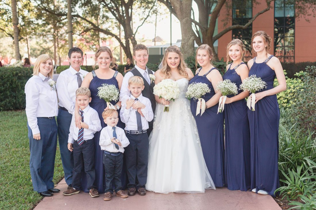 Orlando wedding photographer captures Same sex lgbt Disney wedding at the Swan & Dolphin Resort with reception at the House of Blues in Disney Springs
