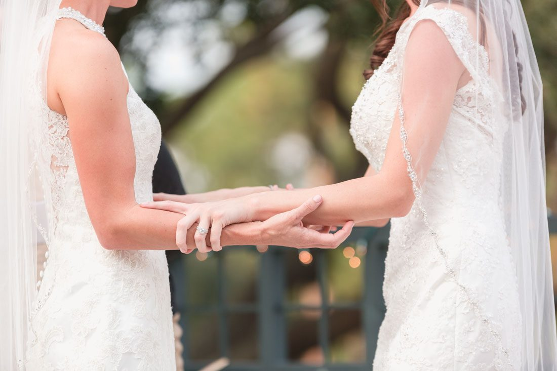 Romantic same-sex wedding at TImacuan golf club in Lake Mary north of Orlando captured by top wedding photographer and videographer