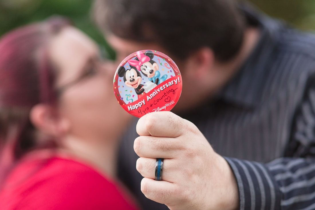Couple celebrates their wedding anniversary with engagement style portrait photography at Disney's grand floridian resort in Orlando
