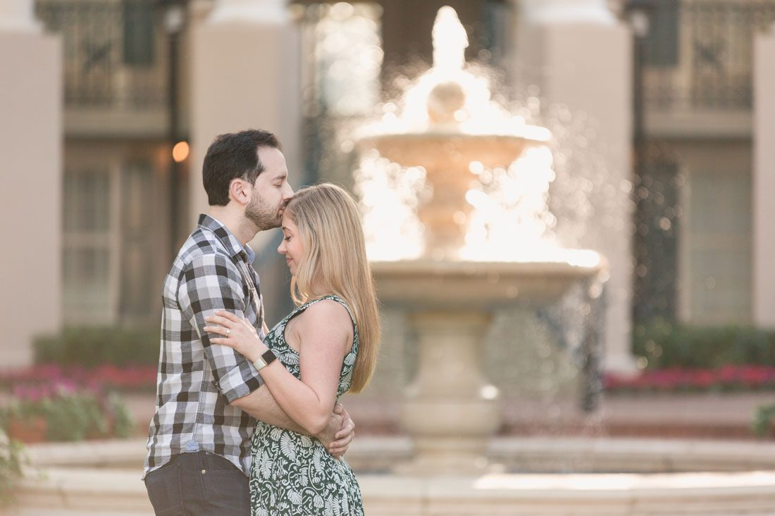 Romantic engagement photo in front of a glowing fountain at Disney Port Orleans Riverside resort captured by top Orlando photographer