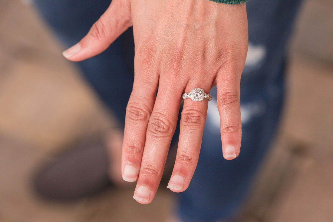 Bride shows off her new engagement ring captured by top Orlando engagement photographer