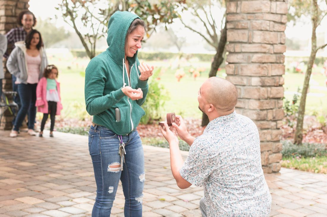 Surprise proposal in winter park captured by top Orlando wedding and engagement photographer